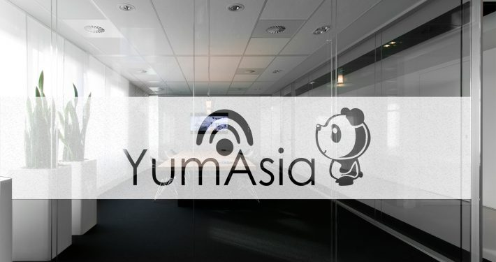Yum Asia logo on a window
