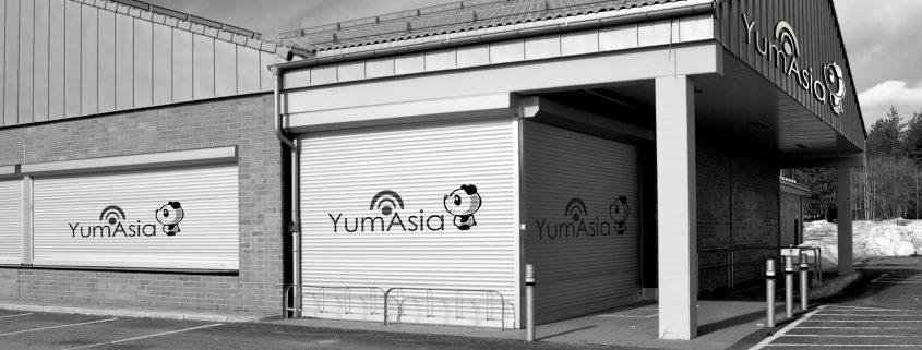 Yum Asia logo on a warehouse