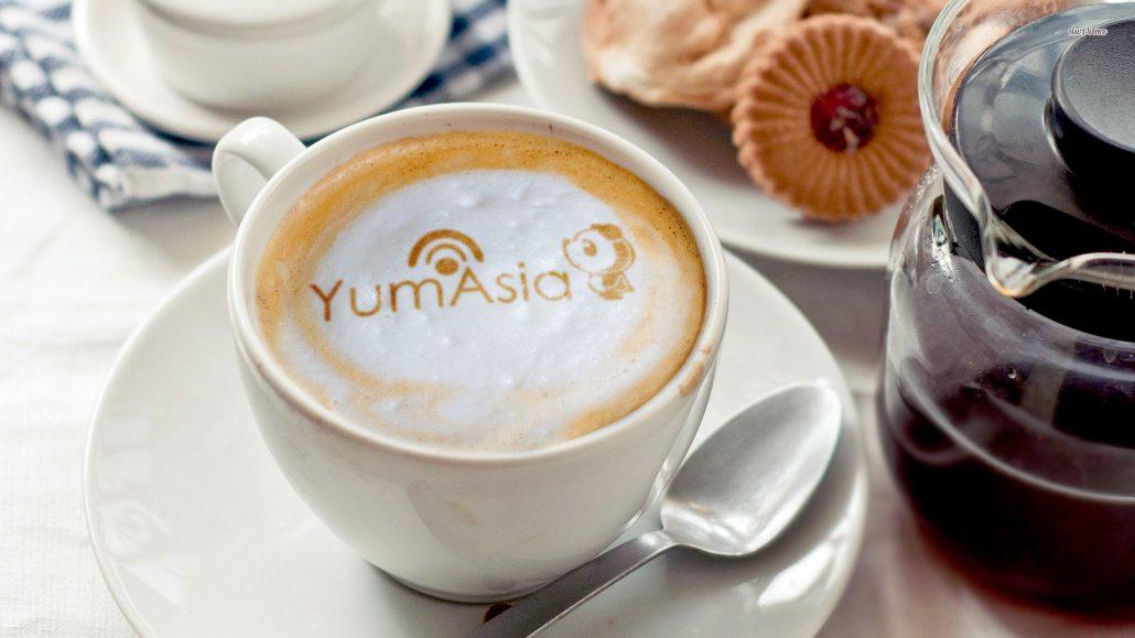 Yum Asia logo on a coffee