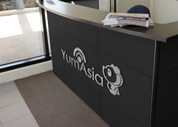 Yum Asia logo on a desk