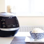 Sakura ceramic rice cooker on a table with rice